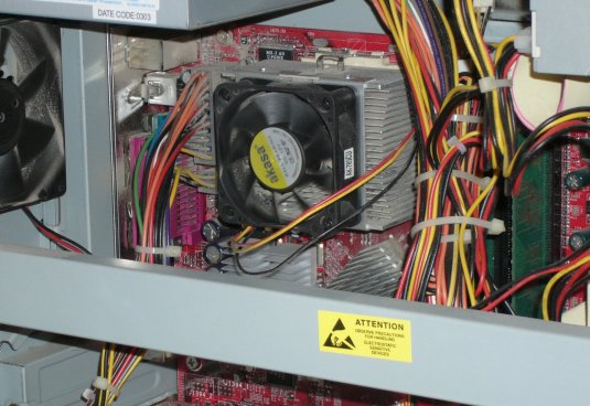 Inside View of a Computer showing Processor Heat Sinc, Cooling Fan, and Power Cables